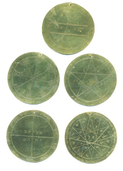 """A set of five engraved metal discs """"The Holy Pentacles or Medals"""" of Mercury, after designs in the Mathers edition of """"The Key of Solomon the King"""" Anonymous."""