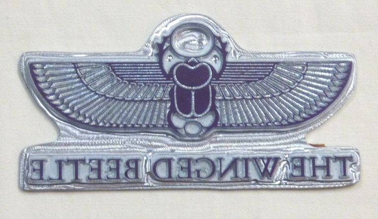 """The original metal printing plate for the cover design of the 1992 Teitan Press facsimile edition of """"The Winged Beetle"""" Aleister. Related material CROWLEY."""